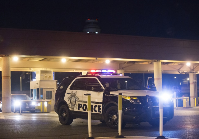 Law enforcement redirect traffic after two people were shot in a domestic incident in the parking garage at McCarran International Airport on Monday, Sept. 19, 2016, in Las Vegas. Benjamin Hager/L ...