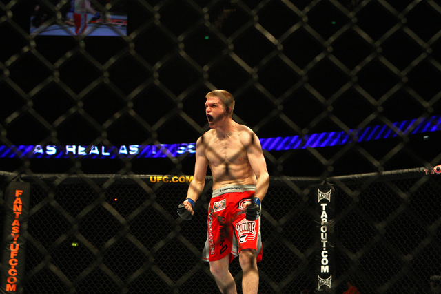Evan Dunham celebrates at an Ultimate Fight Championship event in 2009.  Dunham fights Saturday in Hidalgo, Texas, on the main card of UFC Fight Night 94.  (Tom Hevezi/Associated Press)