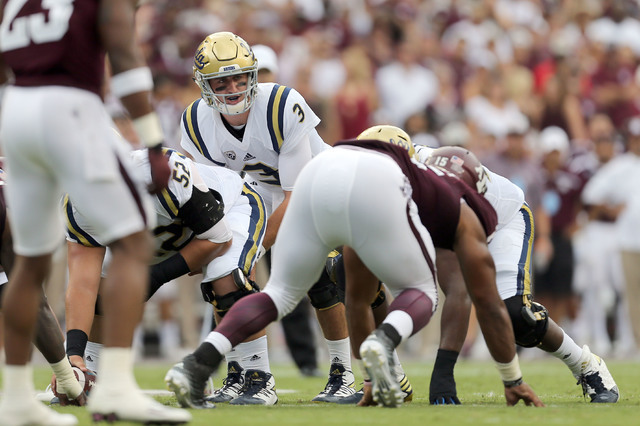 UCLA's quarterback Josh Rosen (3) calls a play at the line of scrimmage during the first quarter of an NCAA college football game against Texas A&M Saturday, Sept. 3, 2016, in College Station, ...