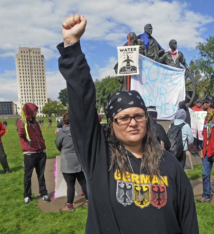 Megan Tobin, of Bellevue, Ohio protests on the grounds of the North Dakota state capitol Friday, Sept. 9, 2016 in Bismarck, N.D. The federal government stepped into the fight over the Dakota Acces ...