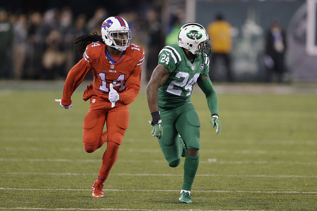 In this Nov. 12, 2015, file photo, Buffalo Bills wide receiver Sammy Watkins, left, is defended by New York Jets cornerback Darrelle Revis during the first half of an NFL football game, in East Ru ...