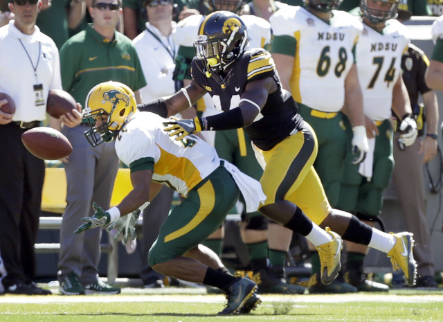 Iowa defensive back Desmond King, right, breaks up a pass intended for North Dakota State wide receiver Darrius Shepherd during the first half of an NCAA college football game, Saturday, Sept. 17, ...
