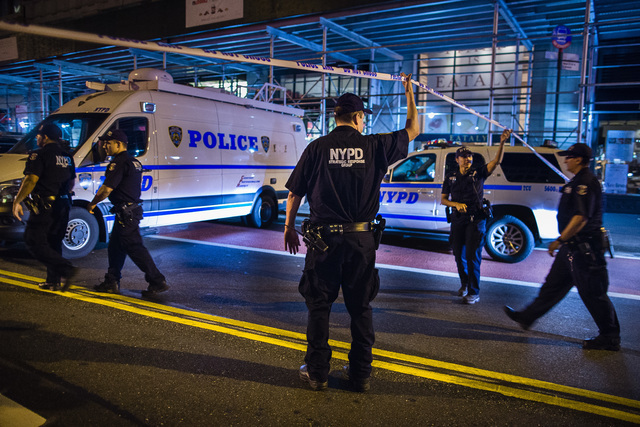 Police arrive on the scene of an explosion in Manhattan's Chelsea neighborhood, in New York, Saturday, Sept. 17, 2016. A law enforcement official tells The Associated Press that an explosion in th ...