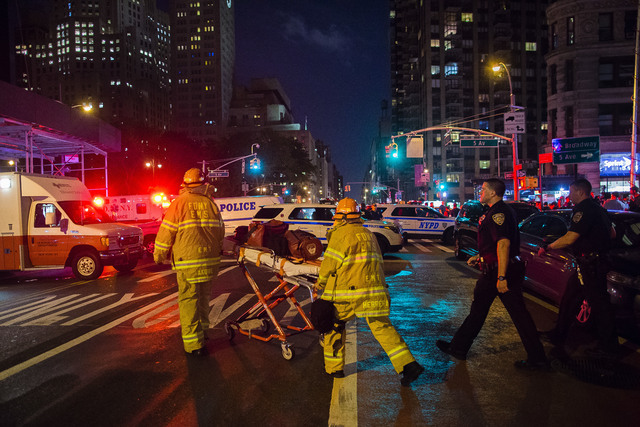 Police and firefighters work near the scene of an apparent explosion in Manhattan's Chelsea neighborhood, in New York, Saturday, Sept. 17, 2016.  (Andres Kudacki/Associated Press)