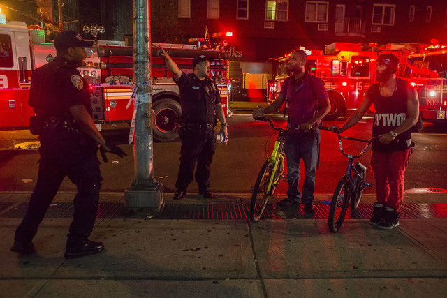 Passersby are redirected by police officers as the police block the street near the scene of an explosion on West 23rd Street and 6th Avenue in Manhattan's Chelsea neighborhood.  (Andres Kudacki/A ...