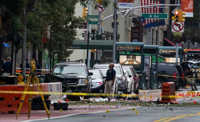 Crime scene investigators work at the scene of Saturday's explosion in Manhattan's Chelsea neighborhood, in New York, Sunday, Sept. 18, 2016. (Craig Ruttle/Associated Press)