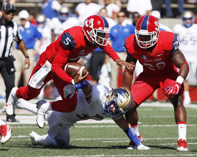 Fresno State's Chason Virgil heads over a Tulsa defender during the first half of an NCAA college football game in Fresno, Calif., Saturday, Sep. 24, 2016. (Gary Kazanjian/AP)