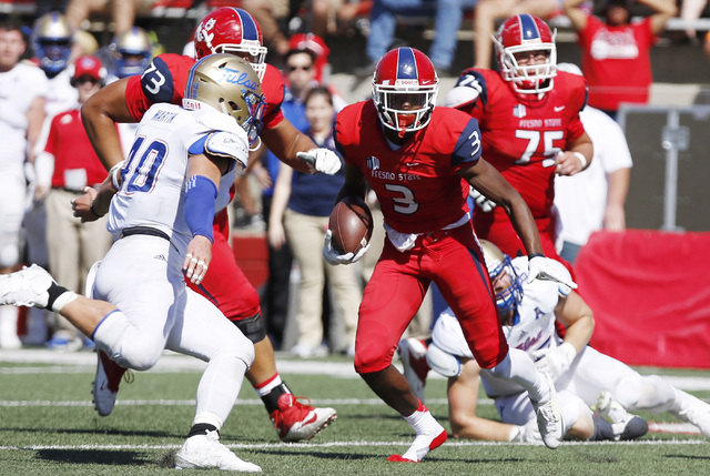 Tulsa's Trent Martin tries to tackle Fresno State's Keesean Johnson during the first half of an NCAA college football game in Fresno, Calif., Saturday, Sep. 24, 2016. (Gary Kazanjian/AP)