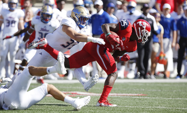 Tulsa's Rob Riederer chases Fresno State's Tyquwan Glass during the first half of an NCAA college football game in Fresno, Calif., Saturday, Sep. 24, 2016. (Gary Kazanjian/AP)