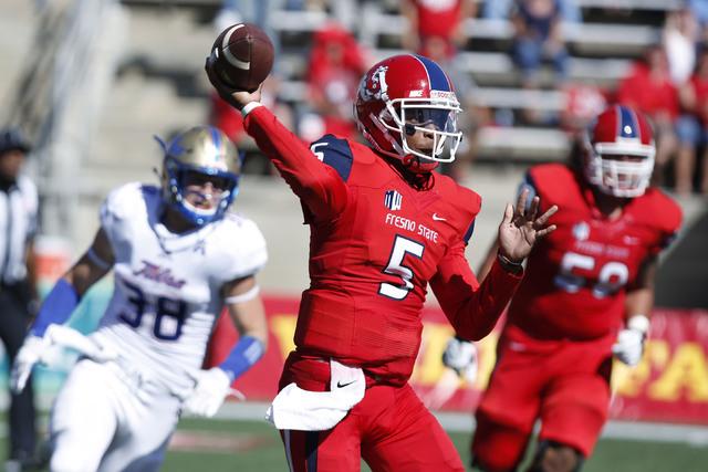Tulsa's Matt Linscott chases Fresno State's Chason Virgil during the first half of an NCAA college football game in Fresno, Calif., Saturday, Sep. 24, 2016. (Gary Kazanjian/AP)