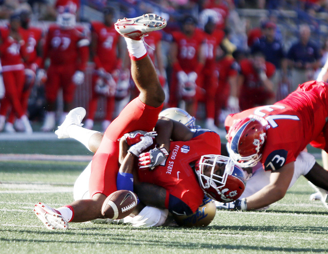 Fresno State's Aaron Peck fumbles the ball against Tulsa in overtime during the second half of an NCAA college football game in Fresno, Calif., Saturday, Sept. 24, 2016. (Gary Kazanjian/AP)