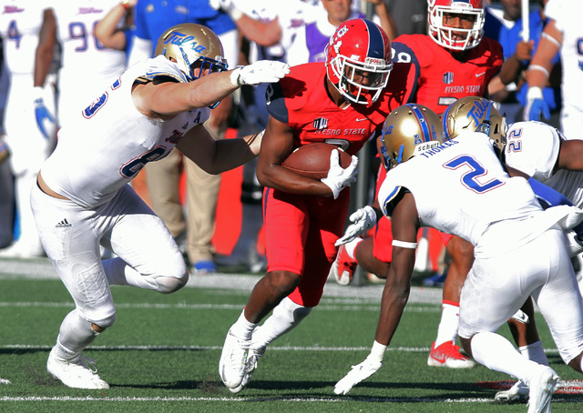 Tulsa's Kerwin Thomas looks to tackle Fresno State's Keesean Johnson during the second half of an NCAA college football game in Fresno, Calif., Saturday, Sept. 24, 2016. (Gary Kazanjian/AP)