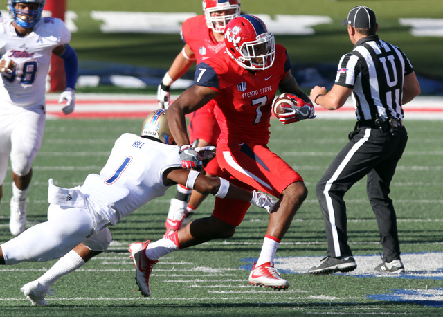 Tulsa's Keanu Hill tries to tackle Fresno State's Aaron Peck during the second half of an NCAA college football game in Fresno, Calif., Saturday, Sept. 24, 2016. (Gary Kazanjian/AP)