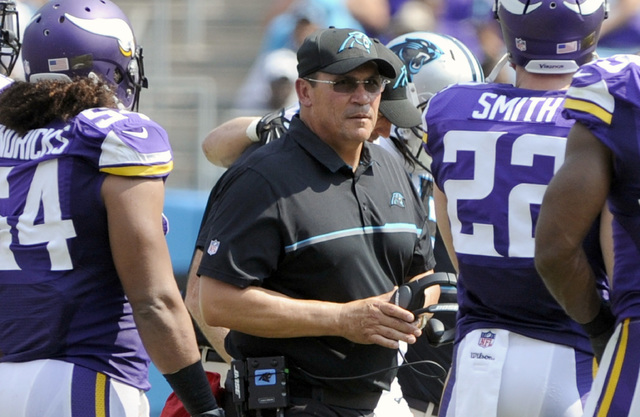 Carolina Panthers head coach Ron Rivera, center, walks through Minnesota Vikings players in the first half of an NFL football game in Charlotte, N.C. in this file photo. Rivera said Monday that tw ...