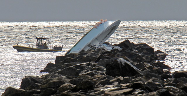 A boat lies overturned on a jetty, Sunday, Sept. 25, 2016, off Miami Beach, Fla. Authorities said that Miami Marlins starting pitcher Jose Fernandez was one of three people killed in the boat cras ...