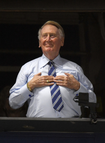 Hall of fame broadcaster Vin Scully acknowledges fans prior a baseball game between the Los Angeles Dodgers and the San Francisco Giants, Tuesday, Sept. 20, 2016, in Los Angeles. (Mark J. Terrill/AP)