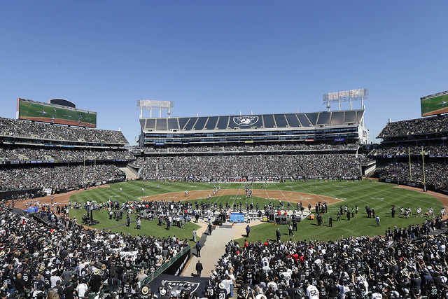 Fans at Oakland Alameda County Coliseum watch the opening kickoff during the first half of an NFL football game between the Oakland Raiders and the Atlanta Falcons in Oakland, Calif., Sunday, Sept ...