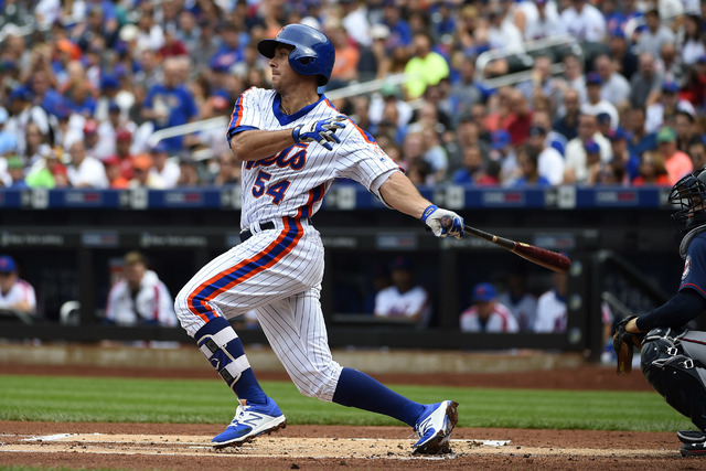 New York Mets' T.J. Rivera hits a single against the Minnesota Twins in a baseball game, Sunday, Sept. 18, 2016, in New York. (Kathy Kmonicek/AP)