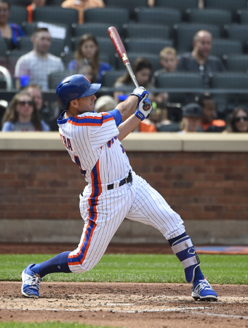 New York Mets' T.J. Rivera swings for a solo home run off of Minnesota Twins starting pitcher Kyle Gibson in the third inning of a baseball game, Sunday, Sept. 18, 2016, in New York. (Kathy Kmonic ...