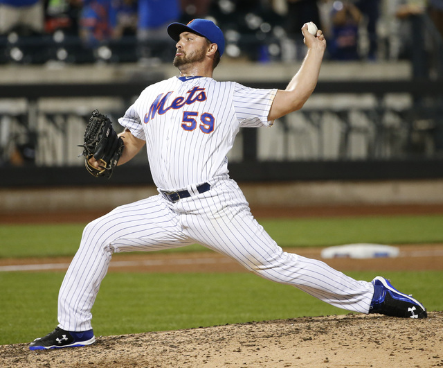 New York Mets relief pitcher Josh Smoker (59) delivers in the ninth inning of a baseball game against the Philadelphia Phillies, Saturday, Aug. 27, 2016, in New York.  (Kathy Willens/AP)
