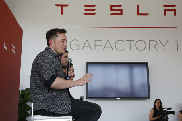 Elon Musk, CEO of Tesla Motors Inc., left, discusses the company's new Gigafactory Tuesday, July 26, 2016, in Sparks. (Rich Pedroncelli/AP)