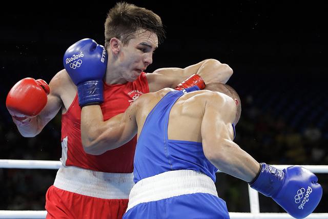 Ireland's Michael John Conlan, left, fights Russia's Vladimir Nikitin during a men's bantamweight 56-kg quarterfinals boxing match at the 2016 Summer Olympics in Rio de Janeiro, Brazil, Tuesday, A ...