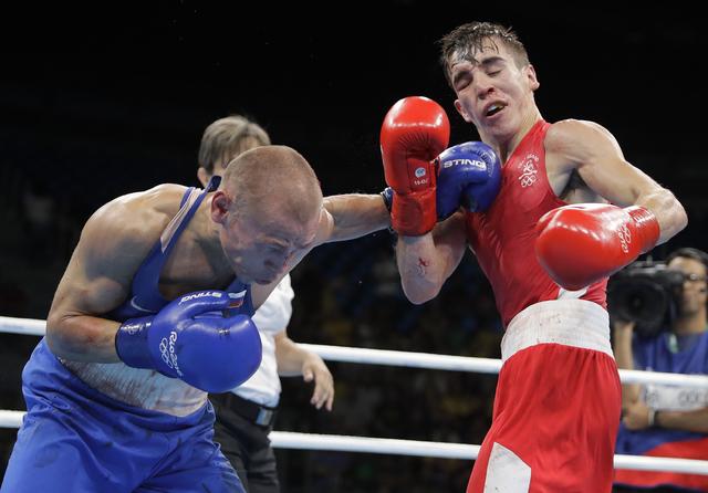 Russia's Vladimir Nikitin, left, fights Ireland's Michael John Conlan during a men's bantamweight 56-kg quarterfinals boxing match at the 2016 Summer Olympics in Rio de Janeiro, Brazil, Tuesday, A ...