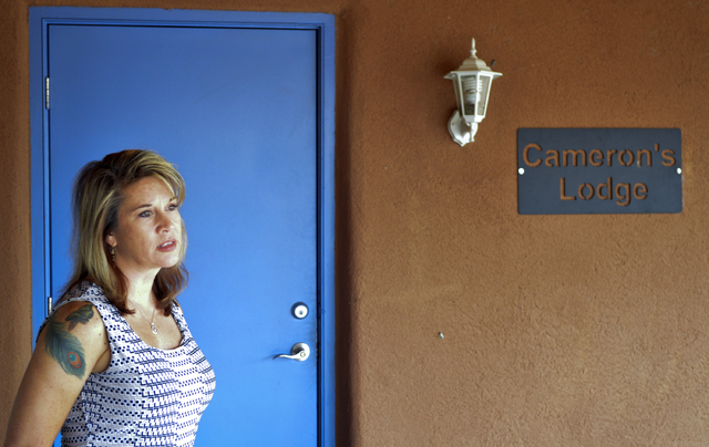 Jennifer Weiss-Burke, executive director of a youth recovery center in Albuquerque, N.M., stands by one of the rooms at the recovery center named after her son, Cameron Weiss. (Mary Hudetz/The Ass ...