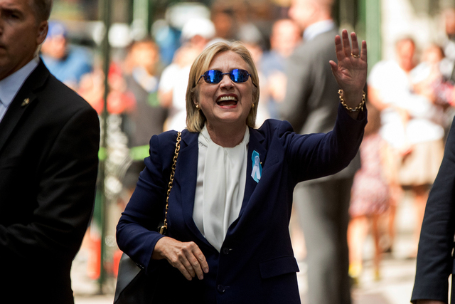 Hillary Clinton waves after leaving an apartment building Sunday, Sept. 11, 2016, in New York. (Andrew Harnik/The Associated Press)