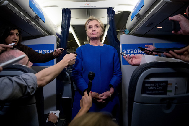 Democratic presidential candidate Hillary Clinton pauses while she remarks on the explosion in Manhattan's Chelsea neighborhood onboard her campaign plane at Westchester County Airport, in White P ...