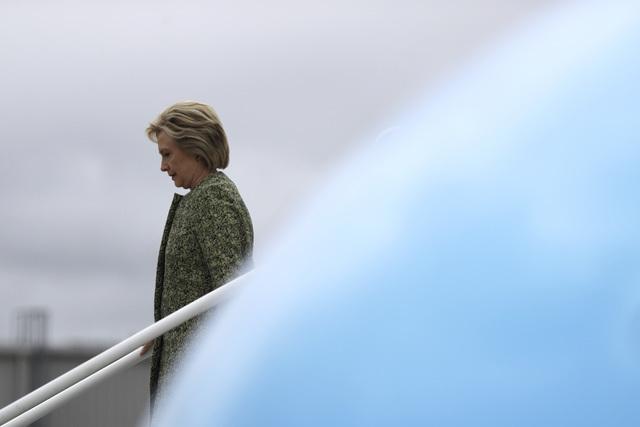 Democratic presidential candidate Hillary Clinton walks off her campaign plane at the Philadelphia International Airport in Philadelphia, Monday, Sept. 19, 2016. (AP Photo/Matt Rourke)