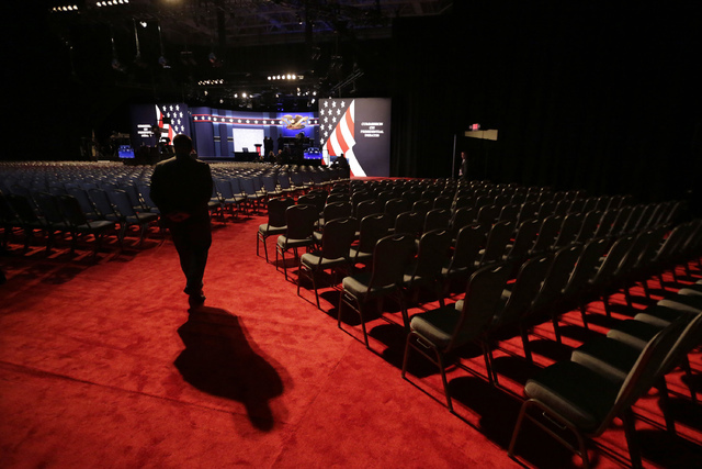 A security official stands in the hall the presidential debate between Democratic presidential candidate Hillary Clinton and Republican presidential candidate Donald Trump at Hofstra University in ...