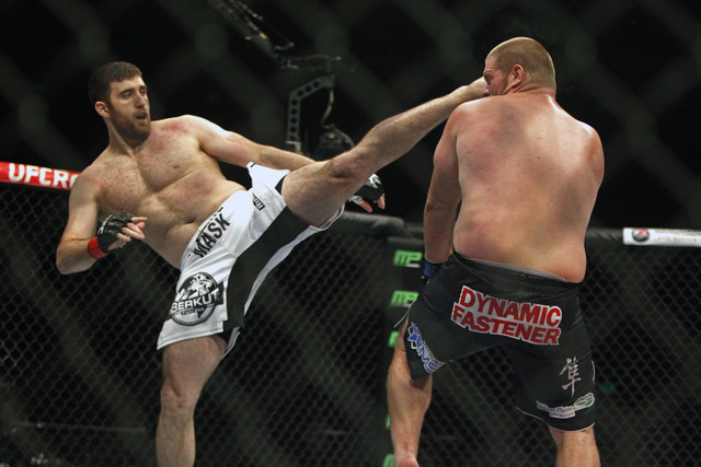 Ruslan Magomedov, left, kicks Josh Copeland during a heavyweight mixed martial arts bout during UFC Fight Night in Austin, Texas, Saturday, Nov. 22, 2014. (Michael Thomas/AP)