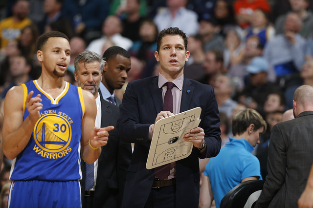 Luke Walton, right, chats with Golden State Warriors guard Stephen Curry (30) during the second half of an NBA basketball game Wednesday, Jan. 13, 2016, in Denver. (David Zalubowski/AP)
