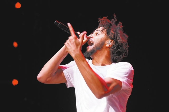 Recording artist J. Cole performs at the 2016 Billboard Hot 100 Music Festival at Nikon at Jones Beach Theater on Sunday, Aug. 21, 2016, in Wantagh, N.Y. (Photo by Scott Roth/Invision/AP)