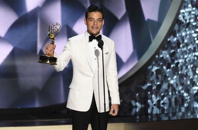 "Rami Malek accepts the award for outstanding lead actor in a drama series for ""Mr. Robot"" at the Microsoft Theater in Los Angeles. (Photo by Chris Pizzello/Invision/AP)"