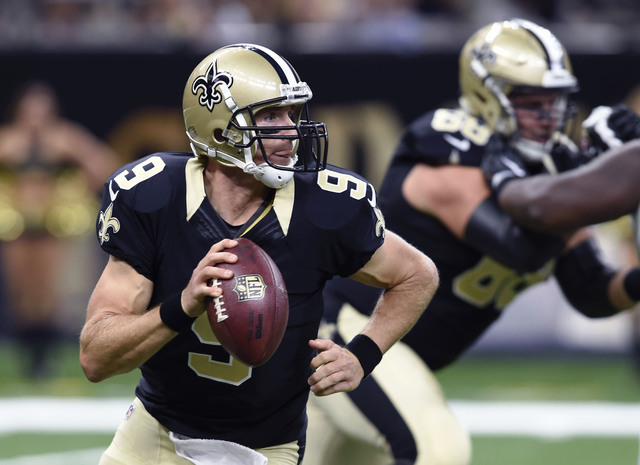 New Orleans Saints quarterback Drew Brees (9) scrambles in the first half of an NFL football game against the Baltimore Ravens in New Orleans, Thursday, Sept. 1, 2016. (AP Photo/Bill Feig)