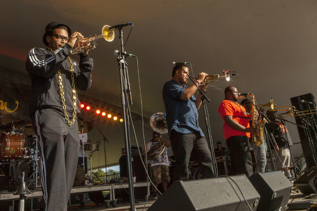 Band members of The Soul Rebels perform at the Voodoo Music Experience on Friday, Oct. 31, 2014, in New Orleans. (Photo by Barry Brecheisen/Invision/AP)