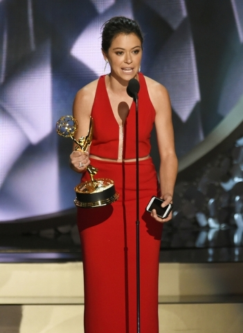 "Tatiana Maslany accepts the award for outstanding lead actress in a drama series for ""Orphan Black"" at the Microsoft Theater in Los Angeles. (Photo by Chris Pizzello/Invision/AP)"