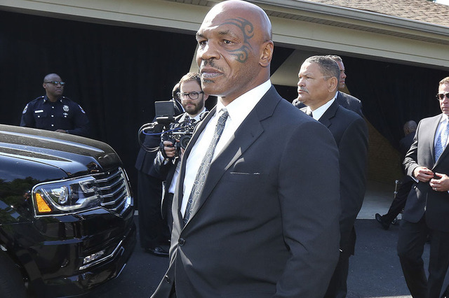 Mike Tyson, center, speaks at the funeral home, Tuesday, June 10, 2016, in Louisville, Ky., before Muhammad Ali's memorial service. Tyson was  a pall bearer for Ali. (Michael Clevenger/The Courier ...