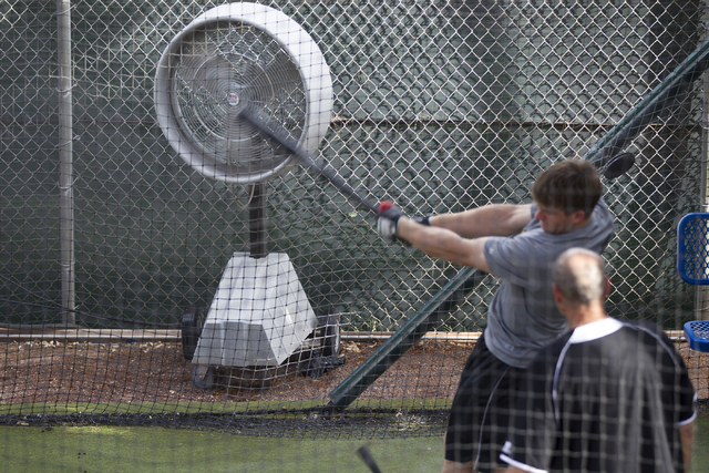 Mist fans keep players cool at the Cashman Field outdoor batting cage before the last home game of the season for the Las Vegas 51s on Saturday, Aug. 27, 2016, in Las Vegas. (Erik Verduzco/Las Veg ...