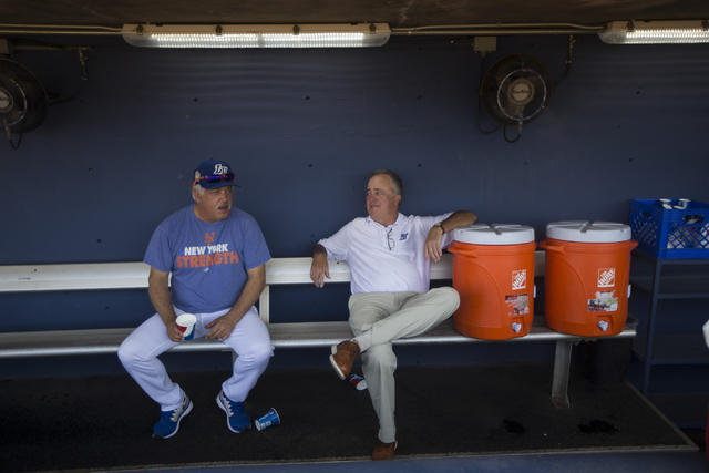 Las Vegas 51s manager Wally Backman, left, and president Don Logan speak to each other at the team dugout before the start of the last home game of the season on Saturday, Aug. 27, 2016, in Las Ve ...