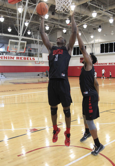 UNLV's Cheickna Dembele (11) shoots over Uche Ofoegbu during team practice at the Mendenhall Center at UNLV in Las Vegas on Monday, Aug. 8, 2016. (Richard Brian/Las Vegas Review-Journal) Follow @v ...