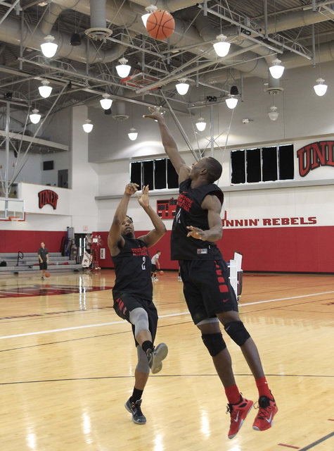 UNLV's Uche Ofoegbu (2) shoots over Cheickna Dembele during team practice at the Mendenhall Center at UNLV in Las Vegas on Monday, Aug. 8, 2016. (Richard Brian/Las Vegas Review-Journal) Follow @ve ...