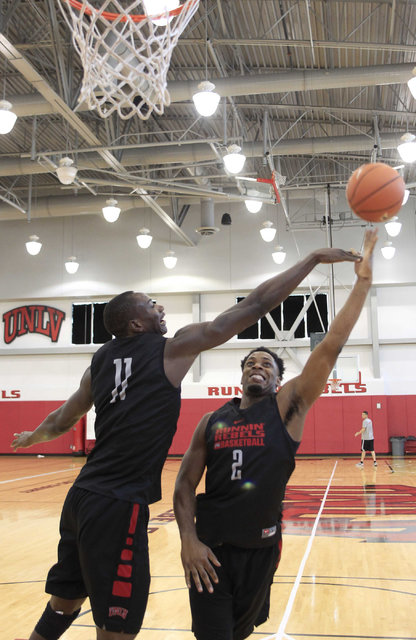 UNLV's Uche Ofoegbu (2) shoots over Cheickna Dembele (11) during team practice at the Mendenhall Center at UNLV in Las Vegas on Monday, Aug. 8, 2016. (Richard Brian/Las Vegas Review-Journal) Follo ...
