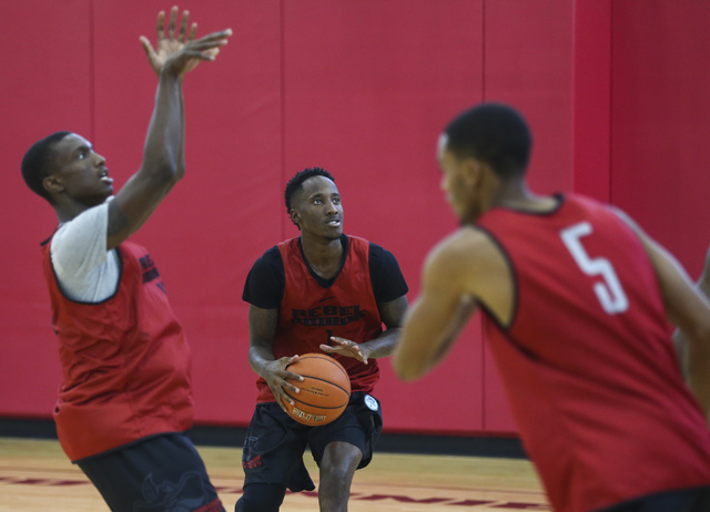 UNLV's Kris Clyburn, center, looks to shoot as teammates Zion Morgan, left, and Jalen Poyser participate during basketball practice at Mendenhall Center at UNLV in Las Vegas on Friday, Sept. 30, 2 ...