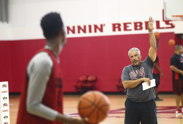 UNLV head coach Marvin Menzies, right, directs UNLV's Ben Coupet during basketball practice at Mendenhall Center at UNLV in Las Vegas on Friday, Sept. 30, 2016. Chase Stevens/Las Vegas Review-Jour ...
