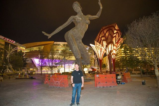 Sculptor Marco Cochrane and his sculpture Bliss Dance at The Park on the Las Vegas Strip. (Barry Toranto)