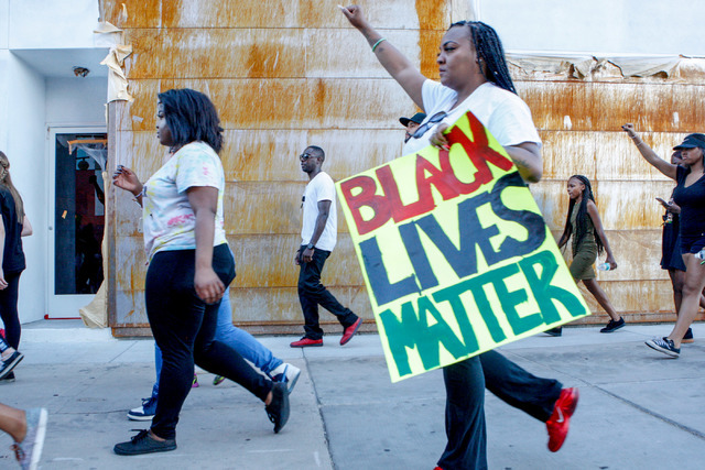 Protesters march in downtown Las Vegas during a Black Lives Matter demonstration on Saturday evening, July 16, 2016. (Elizabeth Brumley/Las Vegas Review-Journal) Follow @Elipagephoto