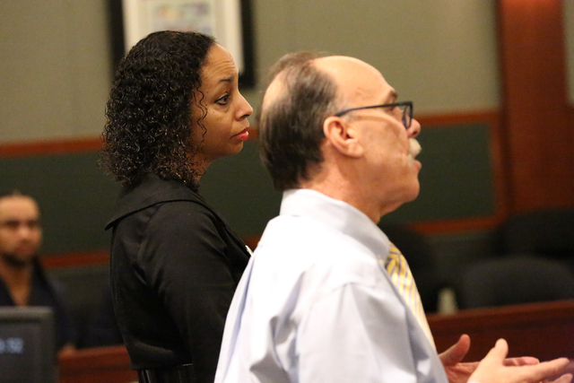 Clark County Public Defender Phil Kohn, right, asks why Erika Ballou should not be allowed to wear a Black Lives Matter pin in the courtroom of District Judge Douglas Herndon on Tuesday, Sept. 20, ...